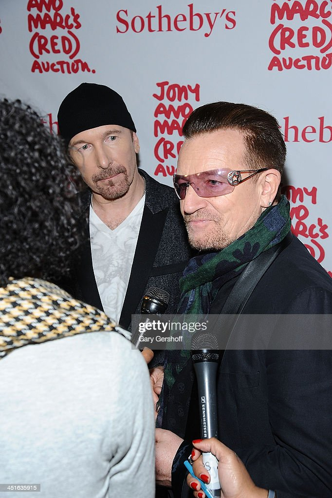 The Edge (L) and <a gi-track='captionPersonalityLinkClicked' href=/galleries/search?phrase=Bono+-+Singer&family=editorial&specificpeople=167279 ng-click='$event.stopPropagation()'>Bono</a> of <a gi-track='captionPersonalityLinkClicked' href=/galleries/search?phrase=U2&family=editorial&specificpeople=201268 ng-click='$event.stopPropagation()'>U2</a> attend the 2013 (RED) Auction Celebrating Masterworks Of Design and Innovation at Sotheby's on November 23, 2013 in New York City.