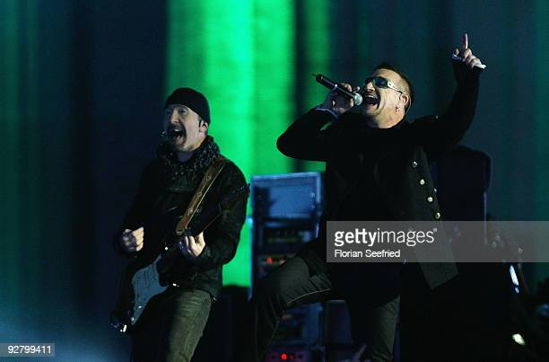 The Edge and Bono of U2 perform during a concert in front of the Brandenburg Gate on November 5 2009 in Berlin Germany U2 performed a free concert in...
