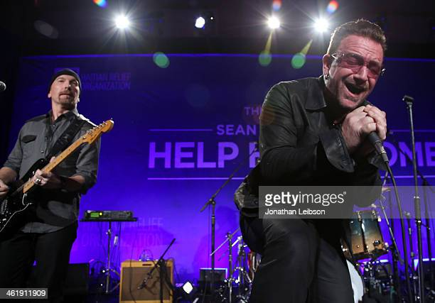 The Edge and Bono of U2 perform onstage during the 3rd annual Sean Penn Friends HELP HAITI HOME Gala benefiting J/P HRO presented by Giorgio Armani...