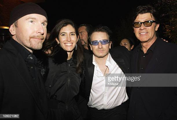 The Edge and Bono of U2 with Robbie Robertson during The 60th Annual Golden Globe Awards Miramax AfterParty Inside at Trader Vic's in Beverly Hills...