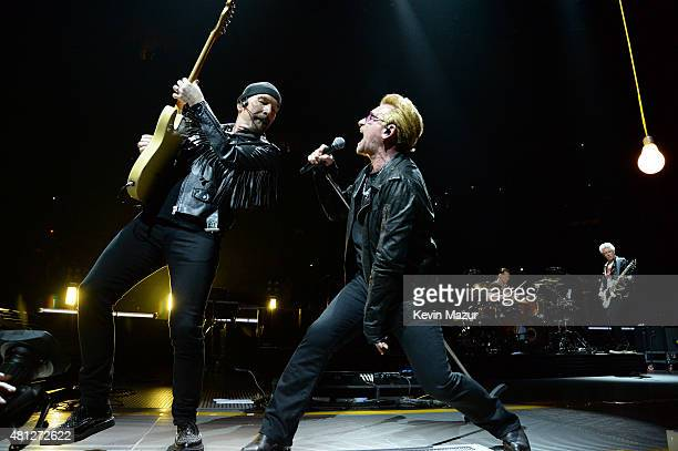 The Edge and Bono perform onstage during U2's iNNOCENCE eXPERIENCE tour at Madison Square Garden on July 18 2015 in New York City