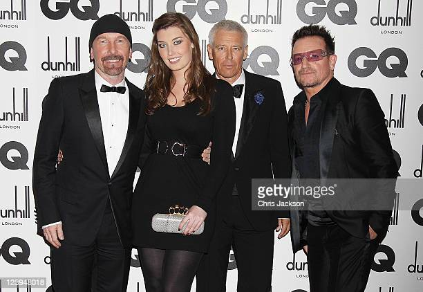 The Edge and guest Adam Clayton and Bono of U2 attend the GQ Men Of The Year Awards at The Royal Opera House on September 6 2011 in London England