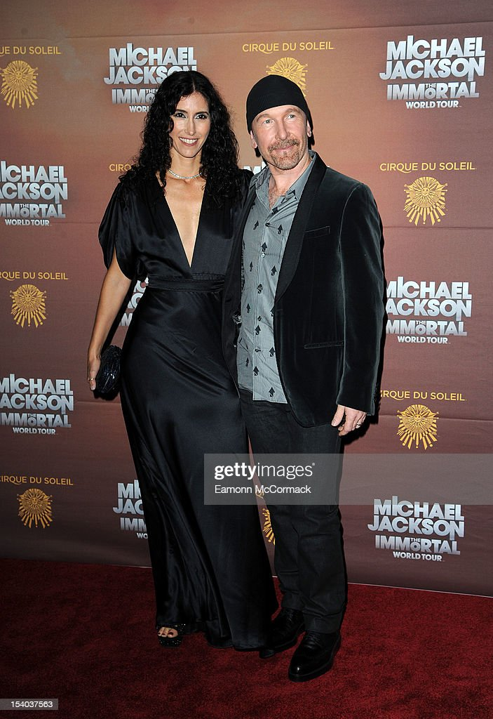 The Edge (R) and Morleigh Steinberg attend the opening night of Cirque Du Soleil's 'Michael Jackson The Immortal World Tour' at 02 Arena on October 12, 2012 in London, England.