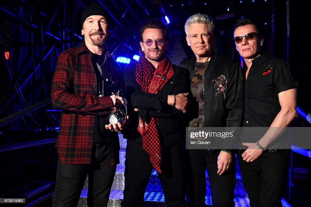 The Edge, Bono, Adam Clayton and Larry Mullen Jr of U2 pose with the Global Icon award during the MTV EMAs 2017 held at The SSE Arena, Wembley on November 12, 2017 in London, England.