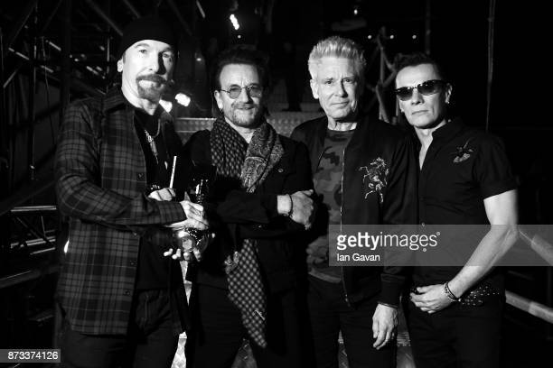The Edge Bono Adam Clayton and Larry Mullen Jr of U2 pose with the Global Icon award during the MTV EMAs 2017 held at The SSE Arena Wembley on...