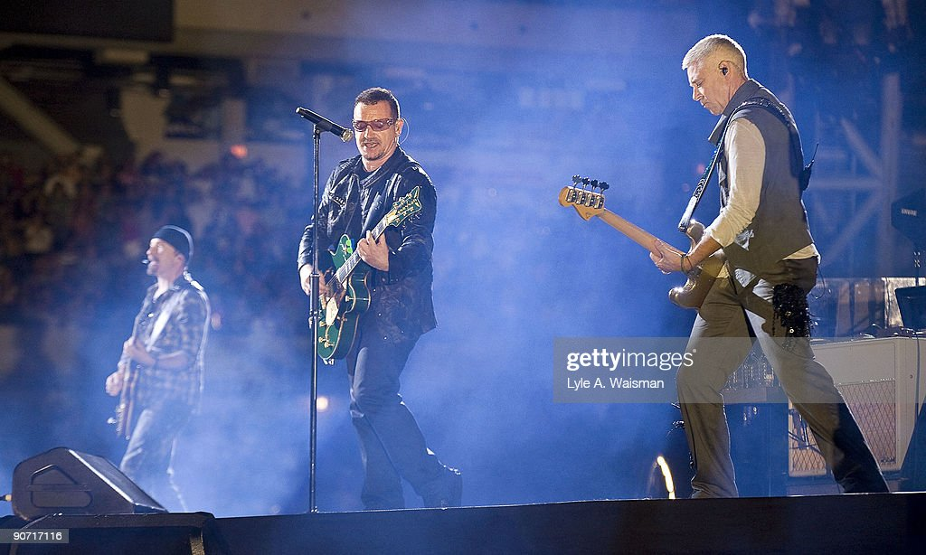 The Edge Bono and Adam Clayton perform during the U2 360 tour at Soldier Field on September 13 2009 in Chicago Illinois