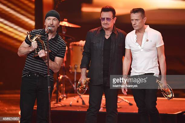 The Edge Bono and Larry Mullen junior of the band U2 are seen on stage during the Bambi Awards 2014 show on November 13 2014 in Berlin Germany