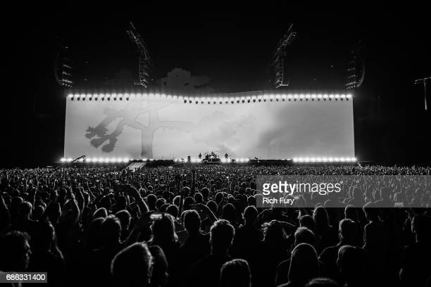 The Edge Bono Larry Mullen Jr and Adam Clayton of U2 perform onstage at the Rose Bowl on May 20 2017 in Pasadena California