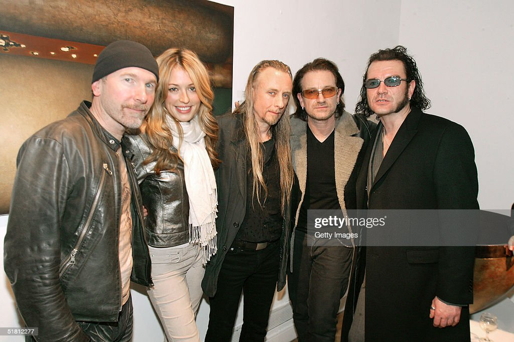 The Edge, Cat Deeley, Guggi, Bono and Gavin Friday attend the opening of the new collection by Irish artist Guggi at the Osbourne Samuel Gallery on December 1, 2004 in London.