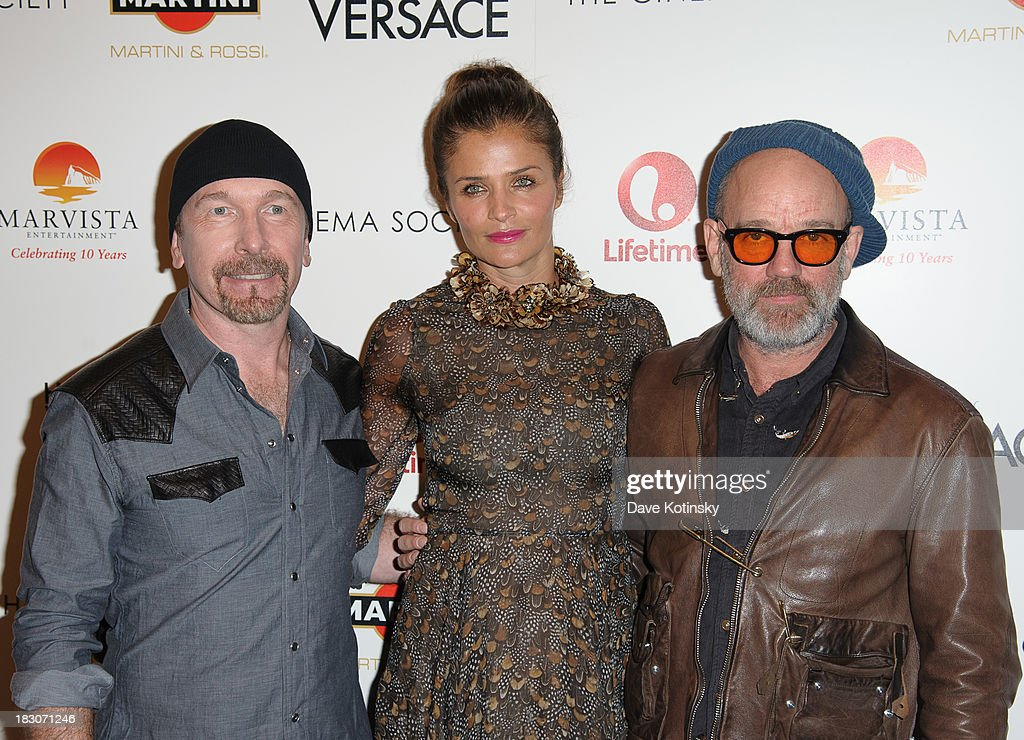The Edge, Helena Christensen and Michael Stipe attends a screening of 'House of Versace' hosted by Marvista Entertainment and Lifetime with The Cinema Society at MOMA on October 3, 2013 in New York City.