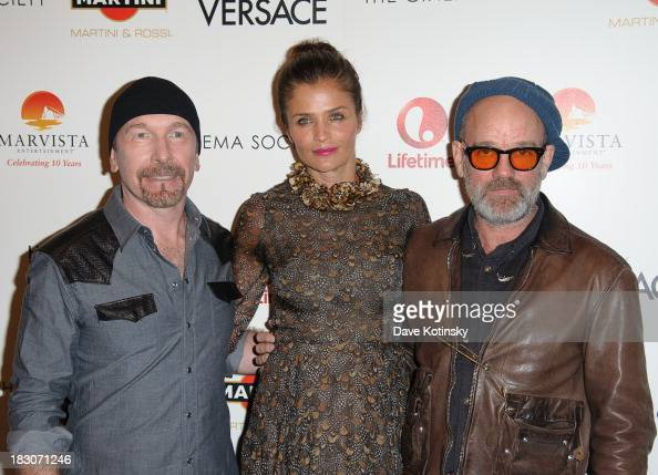 The Edge Helena Christensen and Michael Stipe attends a screening of 'House of Versace' hosted by Marvista Entertainment and Lifetime with The Cinema...