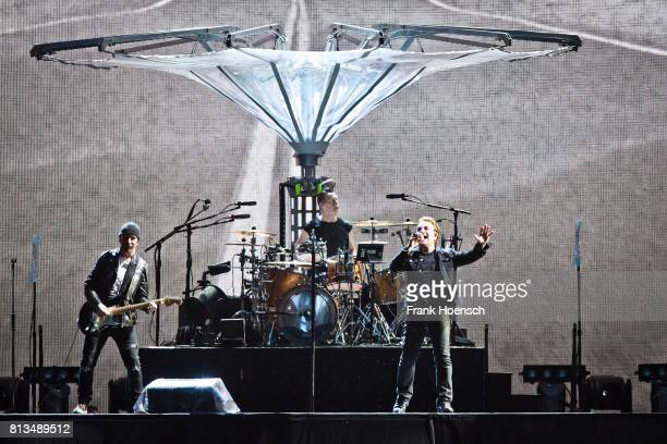 The Edge Larry Mullen Jr and Bono of U2 perform live on stage during a concert at the Olympiastadion on July 12 2017 in Berlin Germany