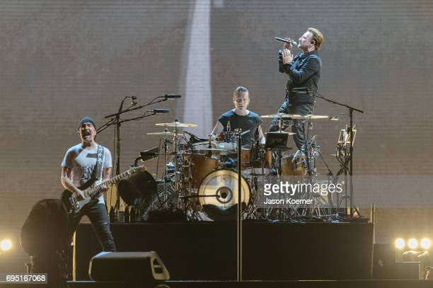 The Edge Larry Mullen Jr and Bono of U2 perform on stage at Hard Rock Stadium on June 11 2017 in Miami Gardens Florida