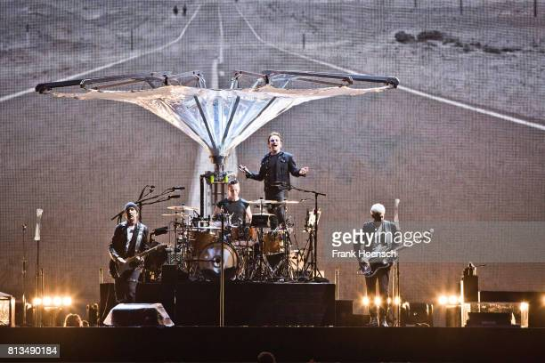 The Edge Larry Mullen Jr Bono and Adam Clayton of U2 perform live on stage during a concert at the Olympiastadion on July 12 2017 in Berlin Germany