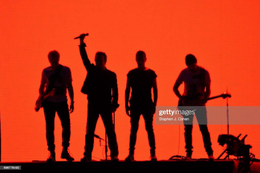 The Edge, Larry Mullen Jr., Bono and Adam Clayton of U2 perform on stage at Papa John's Cardinal Stadium on June 16, 2017 in Louisville, Kentucky.