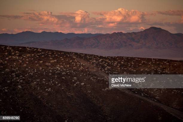 The edge of Amboy Crater and distant mountains are seen just before sunrise at Mojave Trails National Monument on August 27 2017 near Essex...