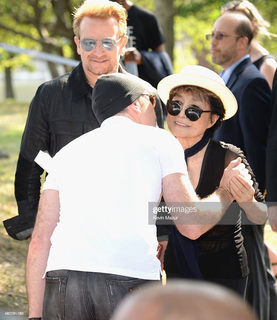 The Edge, Yoko Ono and Bono attend Amnesty International Tapestry Honoring John Lennon Unveiling at Ellis Island on July 29, 2015 in New York City.