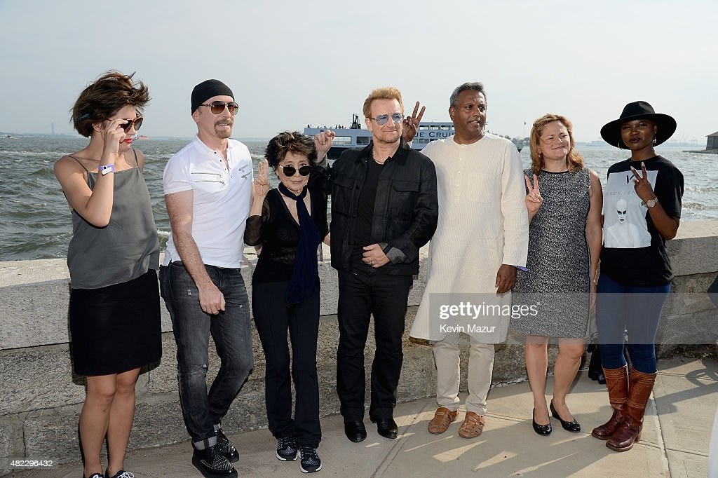 The Edge, Yoko Ono, Bono, Salil Shetty and Melissa Mark-Viverito attend Amnesty International Tapestry Honoring John Lennon Unveiling at Ellis Island on July 29, 2015 in New York City.