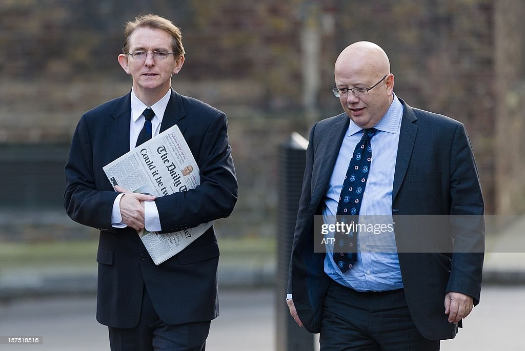 The editor of The Telegraph Tony Gallagher (L) and the editor of The Independent Chris Blackhurst (R) arrive in Downing Street ahead of a meeting to discuss the regulation of newspaper conduct on December 4, 2012. Prime Minister David Cameron met with editors of major British newspapers following proposals set out by judge Brian Leveson in a major report into press ethics in Britain, conducted in the wake of the phone-hacking scandal at Rupert Murdoch's News of the World. AFP PHOTO/Leon Neal