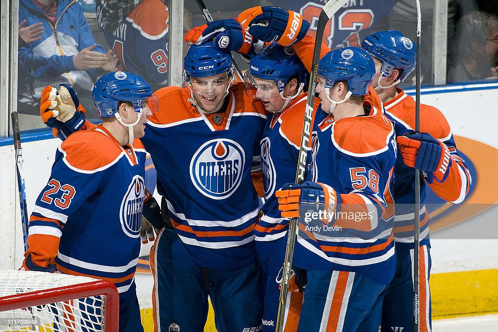 The Edmonton Oilers celebrate a third period goal against the Vancouver Canucks at Rexall Place on April 5, 2011 in Edmonton, Alberta, Canada.