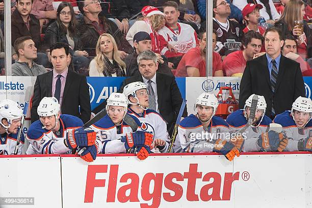 The Edmonton Oilers coaching staff from L to R assistant coach Jay Woodcroft head coach Todd McLellan and assistant coach Ian Herbers watch the...
