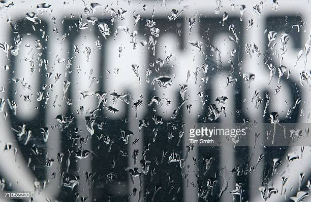 The Edmonton Oilers logo is seen through the rain on a car window prior to game four of the Western Conference Finals between the Mighty Ducks of...