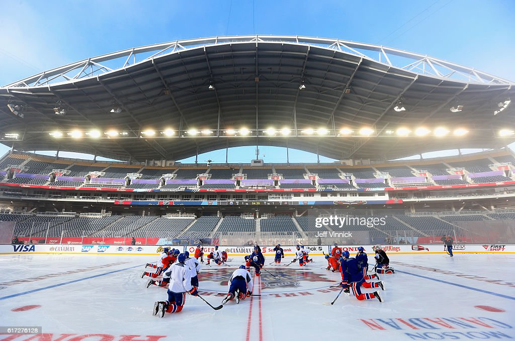 The Edmonton Oilers meet at center ice before practice for the 2016 Tim Hortons NHL Heritage Classic at Investors Group Field on October 22, 2016 in Winnipeg, Canada.