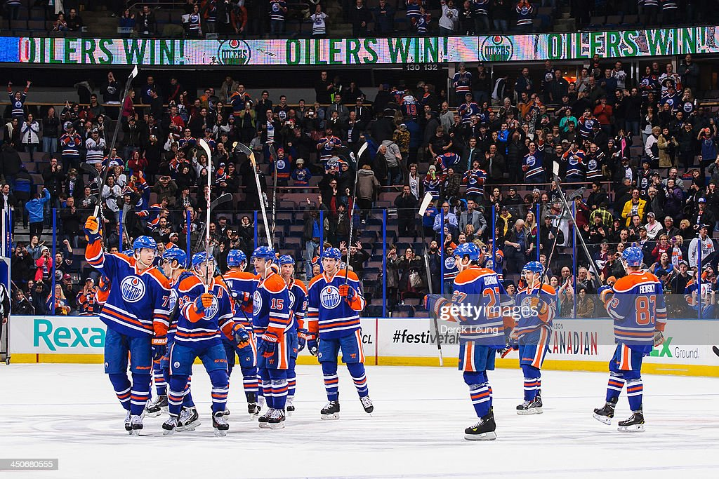 The Edmonton Oilers salute the crowd after defeating the Columbus Blue Jackets during an NHL game at Rexall Place on November 19, 2013 in Edmonton, Alberta, Canada. The Oilers defeated the Blue Jackets 7-0.
