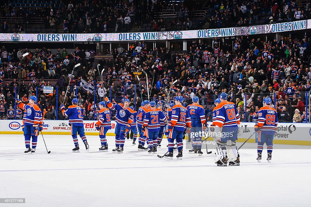 The Edmonton Oilers salute the crowd after defeating the Florida Panthers during an NHL game at Rexall Place on November 21, 2013 in Edmonton, Alberta, Canada. The Oilers defeated the Panthers 4-1.
