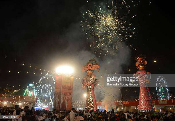 The effigy of demon king Ravana goes up in flames during Dussehra celebrations at Parade Ground in New Delhi