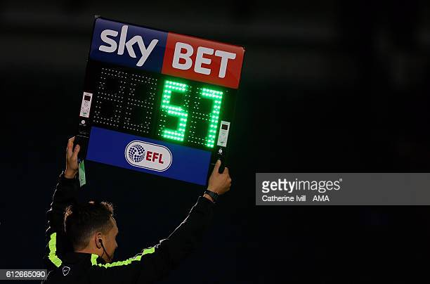 The EFL Sky Bet substitutes board is held up during the Checkatrade trophy match between Wycombe Wanderers and West Ham United at Adams Park on...