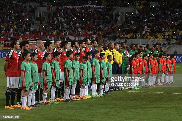 The Egyptian and Nigerian team line up prior to the start of their African Cup of Nations group G qualification football match between Egypt and...
