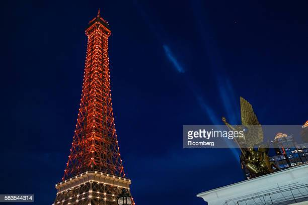 The Eiffel Tower attraction a halfsize replica of the Eiffel Tower in Paris stands illuminated at the Parisian Macao casino resort operated by Sands...