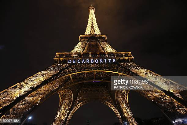 The Eiffel Tower displays the message 'Decarbonize' within the United Nations Climate Conference on Climate Change on December 11 2015 in Paris World...