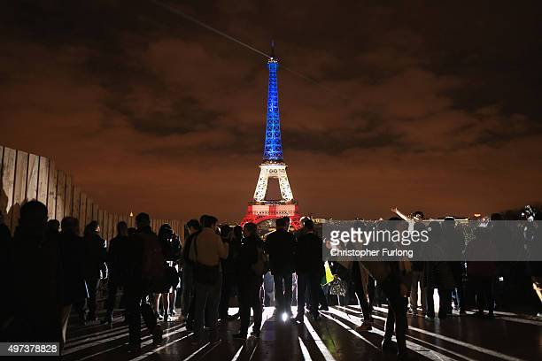 The Eiffel Tower is illuminated in Red White and Blue in honour of the victims of Friday's terrorist attacks on November 16 2015 in Paris France...