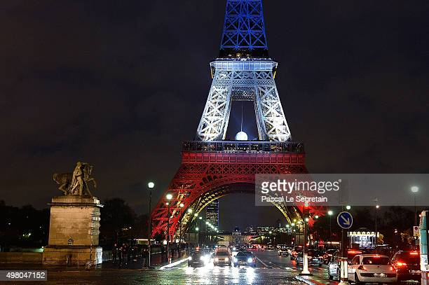 The Eiffel Tower is illuminated in Red White and Blue in honour of the victims of Friday's terrorist attacks on November 20 2015 in Paris France...