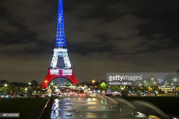 The Eiffel Tower is illuminated in the colors of the French flag in honor of the victims of Friday's terrorist attacks on November 16 2015 in Paris...