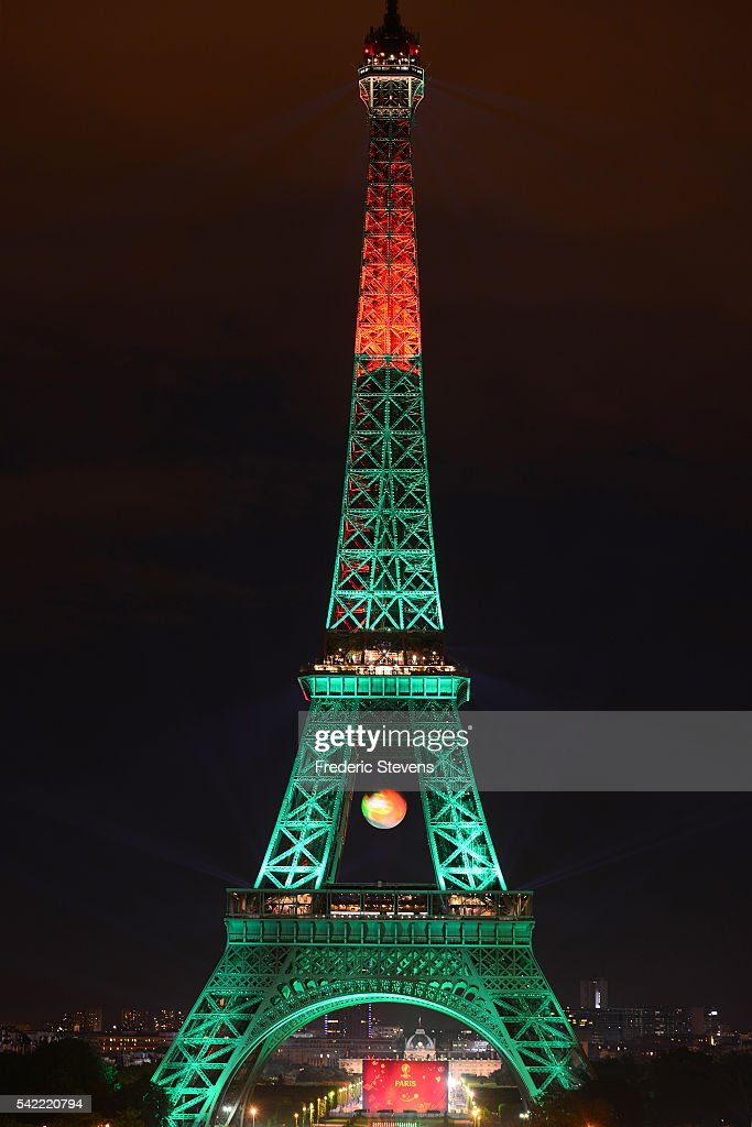 Sport  - Seite 4 The-eiffel-tower-is-lit-up-in-the-colors-representing-portugal-for-picture-id542220794