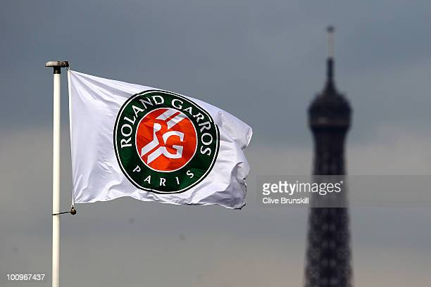 The Eiffel Tower is seen in the background of a flag on day four of the French Open at Roland Garros on May 26 2010 in Paris France
