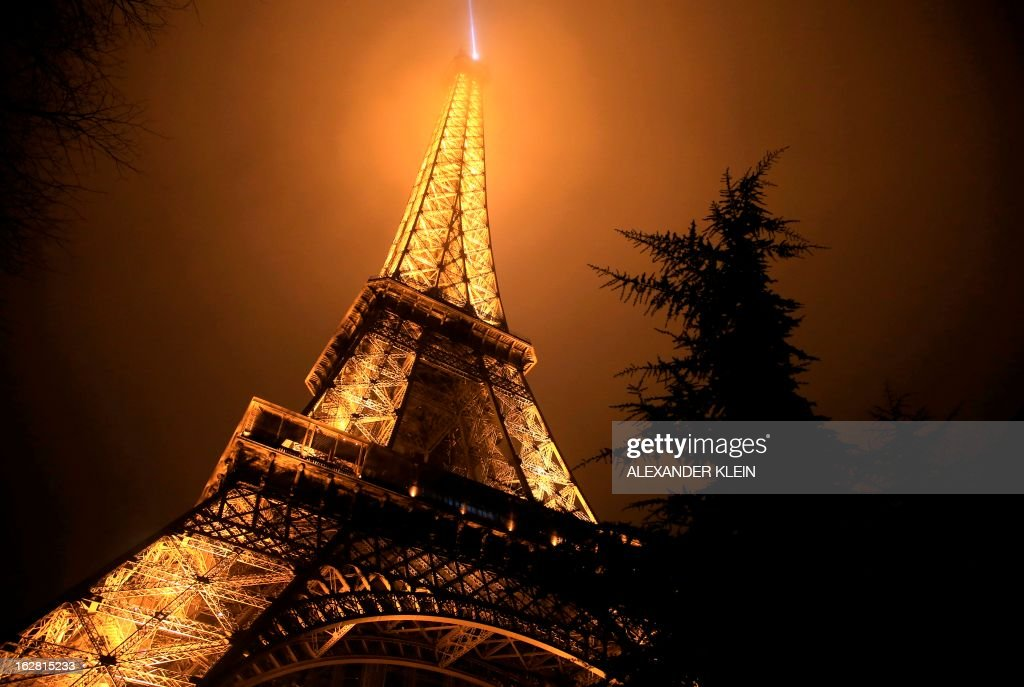 The Eiffel tower is seen on a foggy night in Paris on February 28, 2013. The tower was completed in 1889 and it's current total height is 324 meters.