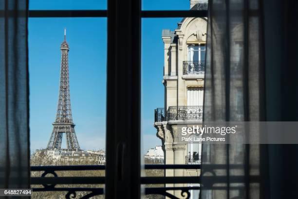 The Eiffel Tower, Paris, France, viewed through a window.