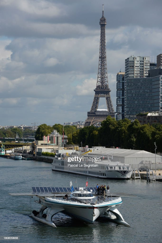 The Eiffel Tower stands in the distance as Turanor PlanetSolar, the largest solar vessel in the world powered exclusively by the sun, departs from Paris on September 15, 2013 in Paris, France. The vessel now docked in the River Seine has been gathering data in the Gulf Stream for five months on oceanic processes interacting with the atmosphere.