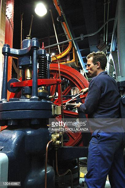 The Eiffel Tower Unveils Its Backstages In Paris France On October 16 2008 a tech checking the waterjack located on the regulator and the belt pulley...