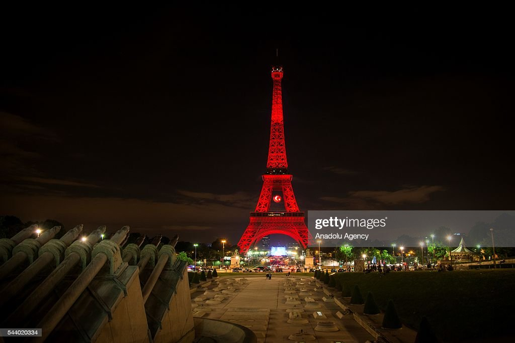 the Eiffel Tower was illuminated in red with a Turkish flag, to honor the victims of the attack in Istanbul airport in Paris, France, on July 01, 2016.
