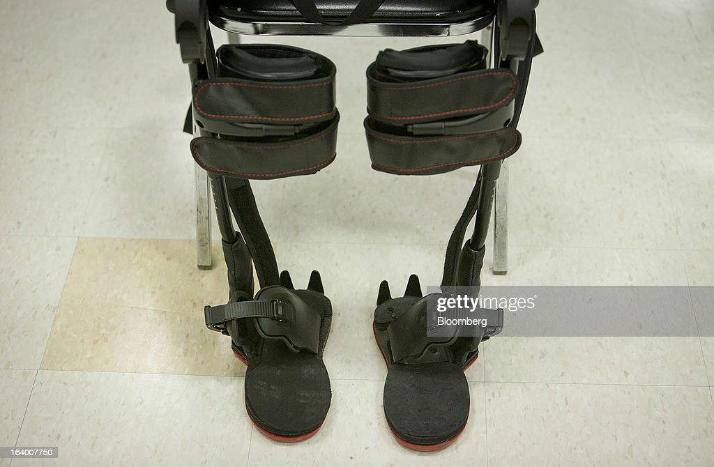 The Ekso Bionics 'exoskeleton,' sits in a chair at Mount Sinai Medical Center in New York, U.S., on Thursday, March 14, 2013. Wearable machines that enhance human muscle power are poised to leave the realm of science fiction and help factory workers hoist heavier tools, lighten soldiers' loads and enable spinal patients to walk. Photographer: Scott Eells/Bloomberg via Getty Images