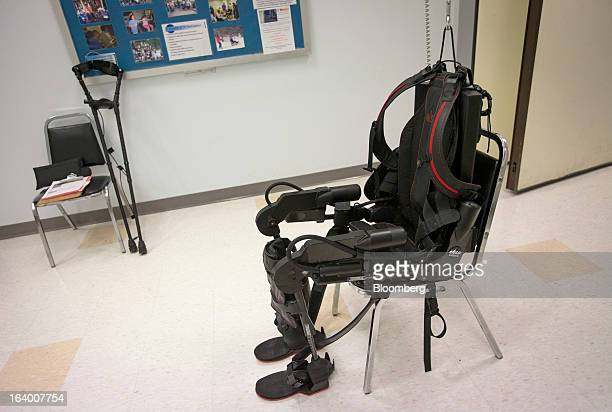 The Ekso Bionics 'exoskeleton' sits in a chair at Mount Sinai Medical Center in New York US on Thursday March 14 2013 Wearable machines that enhance...