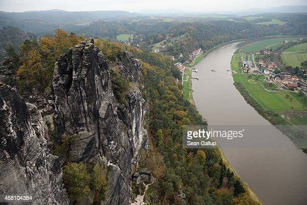 The Elbe River winds past the Bastei rock formation in an area known as Saxon Switzerland on October 24 2014 near Rathen Germany Saechsische Schweiz...