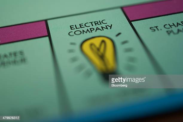 The 'Electric Company' utility square is seen on a Hasbro Inc Monopoly board game arranged for a photograph taken with a tiltshift lens in Oradell...