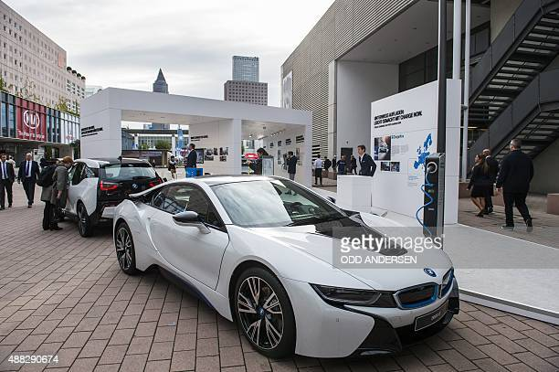 The electric powered BMW i8 and i3 are seen next to a charging point at the 66th IAA auto show in Frankfurt am Main western Germany on September 15...