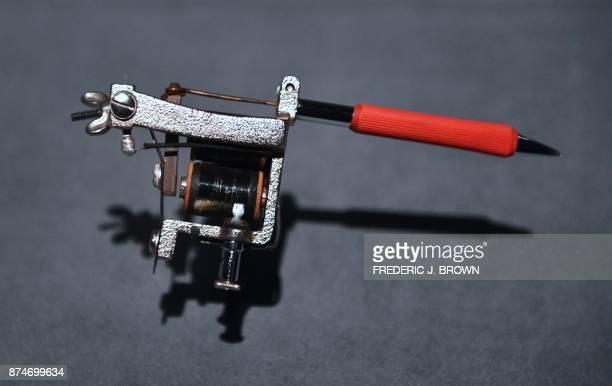 The electric tattoo machine from Milton Zeis businessman tattooist and founder of the first American tattoo club on display as part of the travelling...